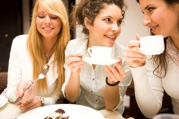 women-having-chocolate-cake-at-party